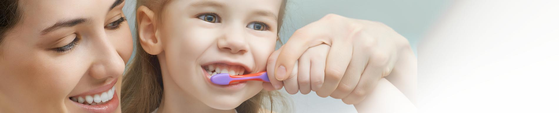 https://www.healthychildren.org/SiteCollectionImage-Homepage-Banners/brushing_childs_teeth_banner.jpg
