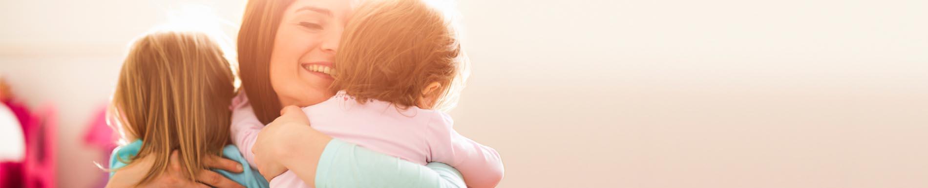 https://www.healthychildren.org/SiteCollectionImage-Homepage-Banners/mom_hug_babies_sweet_md_banner.jpg