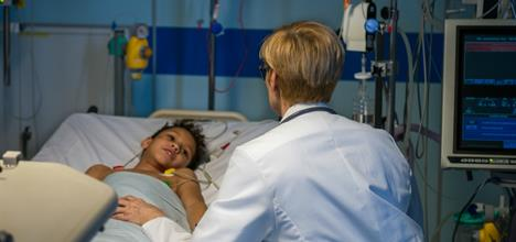 What is a pediatric critical care specialist?