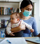 https://www.healthychildren.org/SiteCollectionImagesArticleImages/mother-with-face-protective-mask-working-from-home.jpg?csf=1&e=h3zfEg